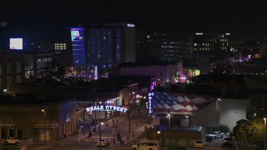 5.7K stock footage aerial video of orbiting the Beale Street sign at nighttime, Downtown Memphis, Tennessee Aerial Stock Footage | DX0002_188_027