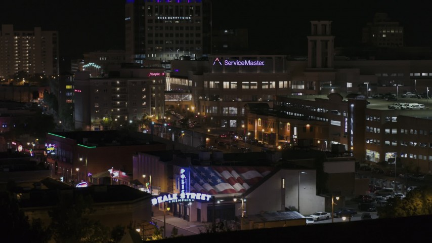 5.7K stock footage aerial video view of office complex, ascend to reveal the Beale Street sign at nighttime, Downtown Memphis, Tennessee Aerial Stock Footage | DX0002_188_030