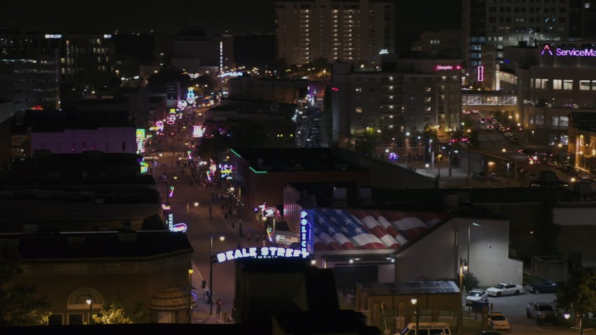 5.7K stock footage aerial video of circling the Beale Street sign at nighttime, Downtown Memphis, Tennessee Aerial Stock Footage | DX0002_188_031