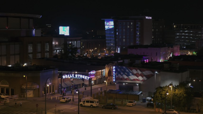 5.7K stock footage aerial video of a static view of the Beale Street sign at nighttime, Downtown Memphis, Tennessee Aerial Stock Footage | DX0002_188_032