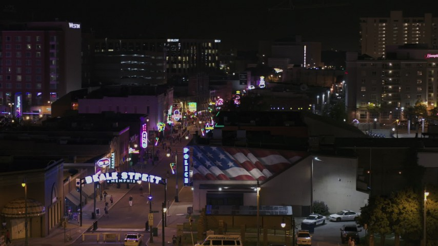 5.7K stock footage aerial video of passing the Beale Street sign at nighttime, Downtown Memphis, Tennessee Aerial Stock Footage | DX0002_188_033