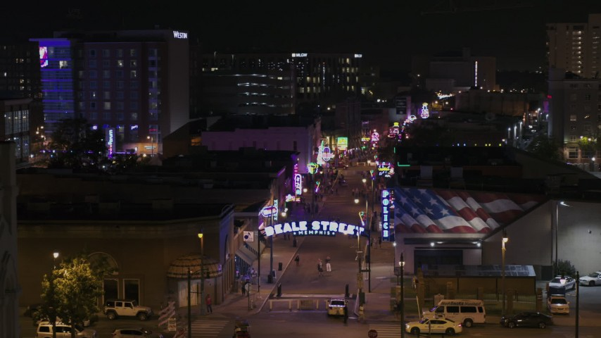 5.7K stock footage aerial video orbit the Beale Street sign for view down the street at nighttime, Downtown Memphis, Tennessee Aerial Stock Footage | DX0002_188_034