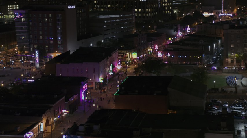 5.7K stock footage aerial video flyby clubs and restaurants on Beale Street at nighttime, Downtown Memphis, Tennessee Aerial Stock Footage | DX0002_188_035