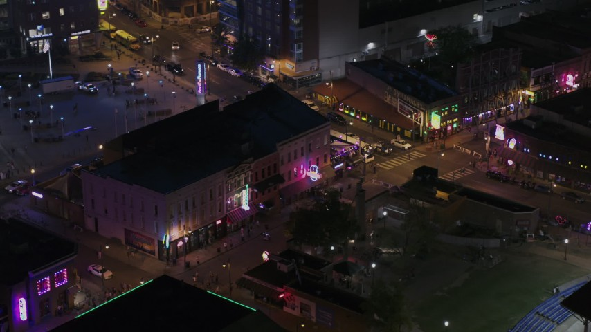5.7K stock footage aerial video orbit clubs and restaurants on Beale Street at nighttime, Downtown Memphis, Tennessee Aerial Stock Footage | DX0002_188_036