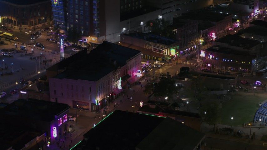 5.7K stock footage aerial video of circling clubs and restaurants on Beale Street at nighttime, Downtown Memphis, Tennessee Aerial Stock Footage | DX0002_188_037