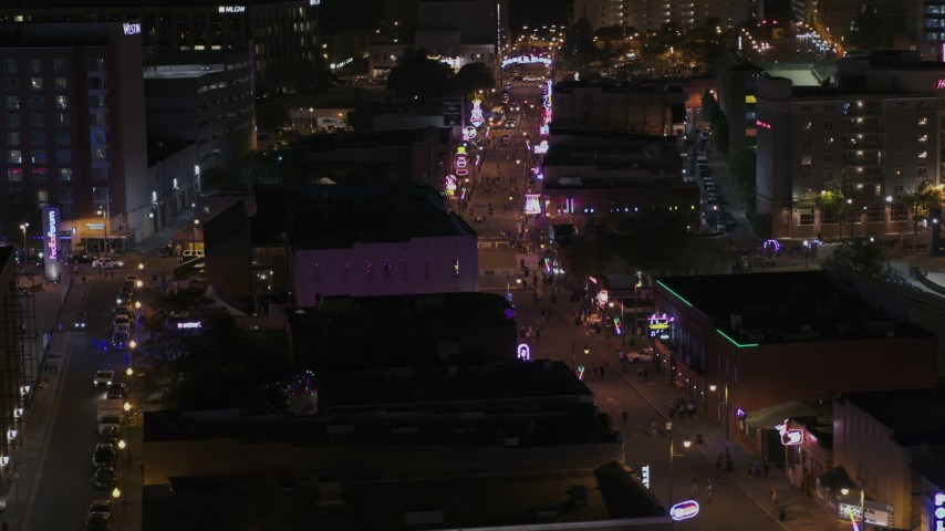 5.7K stock footage aerial video of flying by numerous Beale Street clubs and restaurants at nighttime, Downtown Memphis, Tennessee Aerial Stock Footage | DX0002_188_038