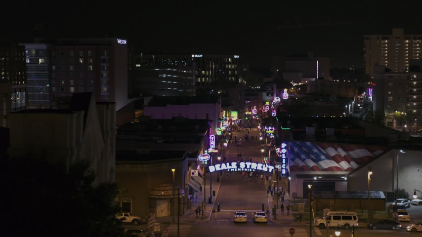 5.7K stock footage aerial video of flying by arena to reveal numerous Beale Street clubs and restaurants at nighttime, Downtown Memphis, Tennessee Aerial Stock Footage | DX0002_188_039