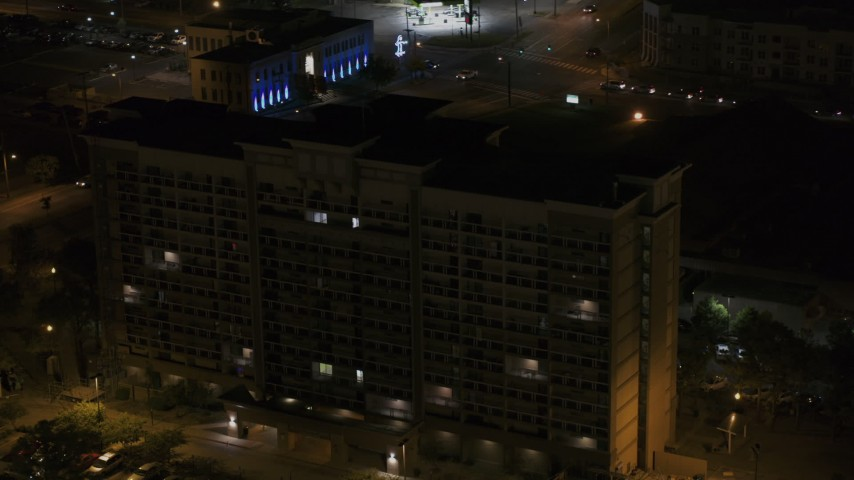 5.7K stock footage aerial video approach and fly away from an office building at nighttime, Memphis, Tennessee Aerial Stock Footage | DX0002_188_042