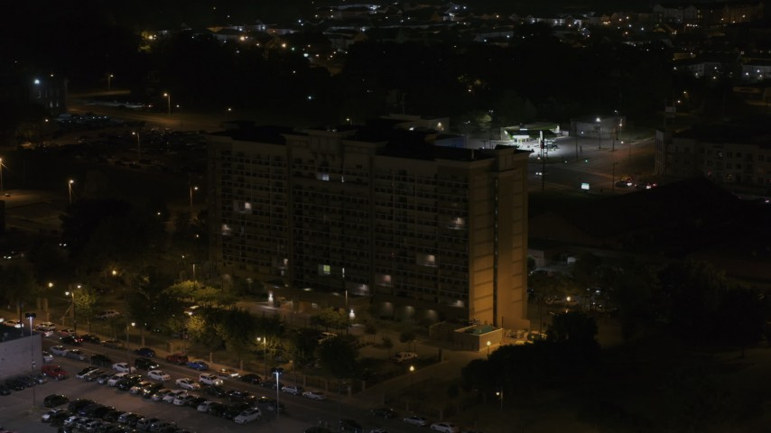 5.7K stock footage aerial video of flying away from, then orbiting an office building at nighttime, Memphis, Tennessee Aerial Stock Footage | DX0002_188_043
