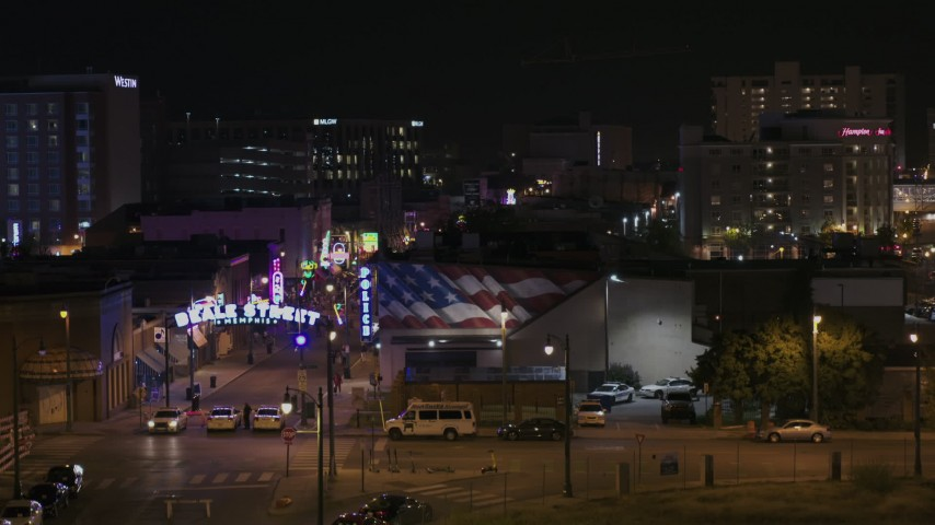 5.7K stock footage aerial video reveal the Beale Street sign while descending by clubs and restaurants at nighttime, Downtown Memphis, Tennessee Aerial Stock Footage | DX0002_188_047