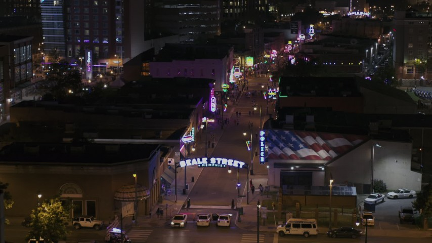 5.7K stock footage aerial video ascend while focused on the Beale Street sign near clubs and restaurants at nighttime, Downtown Memphis, Tennessee Aerial Stock Footage | DX0002_188_048