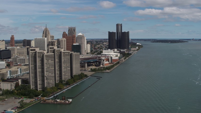 5.7K stock footage aerial video of skyline seen from the river, and then approach Downtown Detroit, Michigan Aerial Stock Footage | DX0002_189_002
