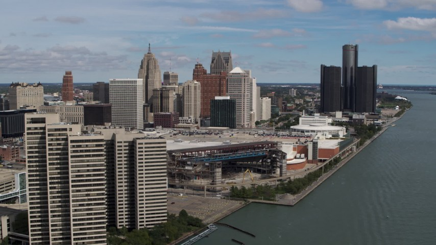 5.7K stock footage aerial video of flyby apartment complex toward arena and skyline, Downtown Detroit, Michigan Aerial Stock Footage | DX0002_189_003