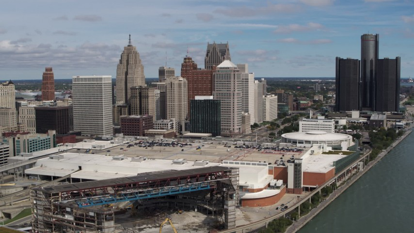 5.7K stock footage aerial video of flying by the arena and convention center to approach skyline, Downtown Detroit, Michigan Aerial Stock Footage | DX0002_189_005