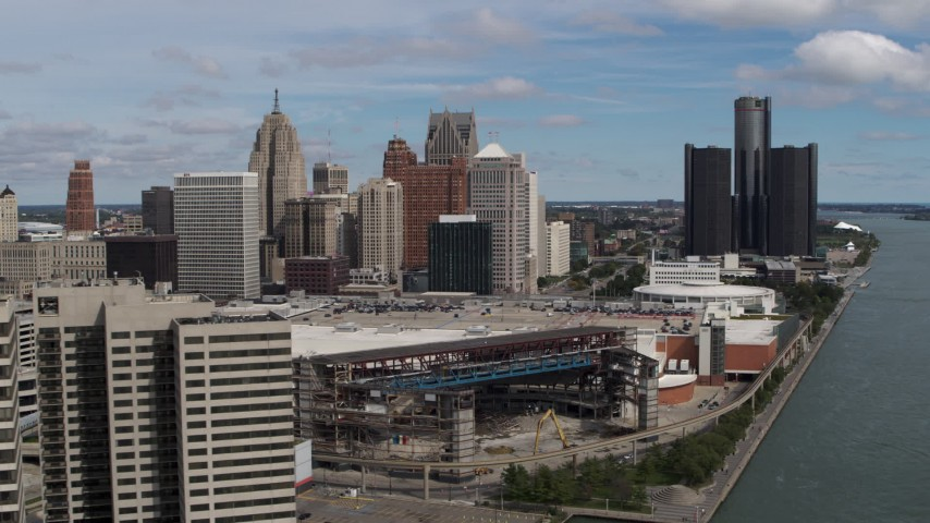 5.7K stock footage aerial video fly away from the arena and skyline, reveal apartment towers, Downtown Detroit, Michigan Aerial Stock Footage | DX0002_189_007