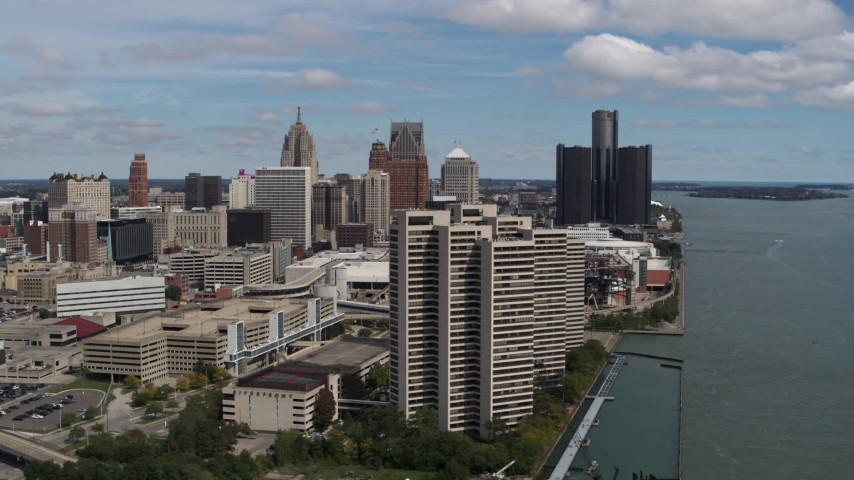 5.7K stock footage aerial video fly away from apartment towers with skyline in the distance, Downtown Detroit, Michigan Aerial Stock Footage | DX0002_189_008