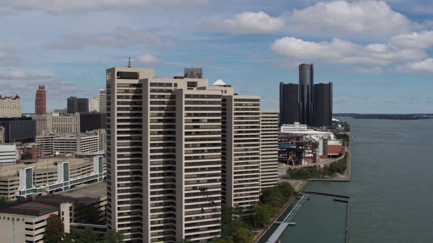 5.7K stock footage aerial video flyby apartment complex with skyscraper in the distance, Downtown Detroit, Michigan Aerial Stock Footage | DX0002_189_010