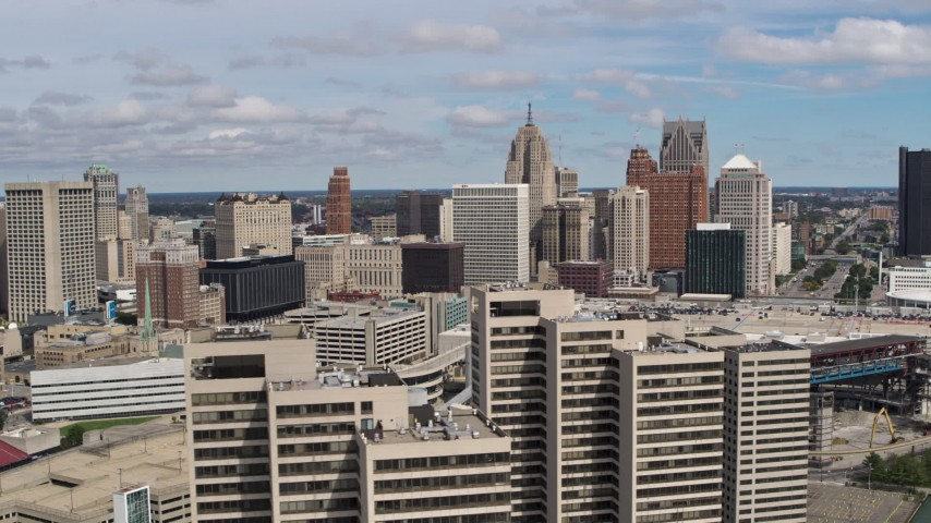 5.7K stock footage aerial video fly away skyline, reveal apartment towers, Downtown Detroit, Michigan Aerial Stock Footage | DX0002_189_012