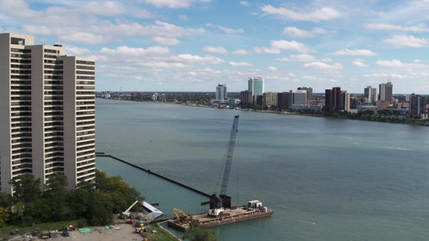 5.7K stock footage aerial video flyby apartment complex for view of the Windsor, Ontario skyline across the river, Downtown Detroit, Michigan Aerial Stock Footage | DX0002_189_015