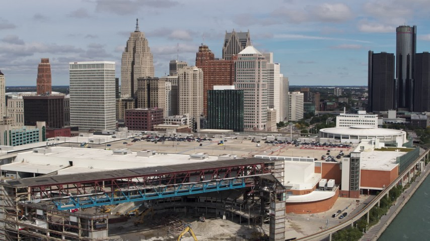 5.7K stock footage aerial video flying by apartment towers, arena and convention center, focus on skyline, Downtown Detroit, Michigan Aerial Stock Footage | DX0002_189_016