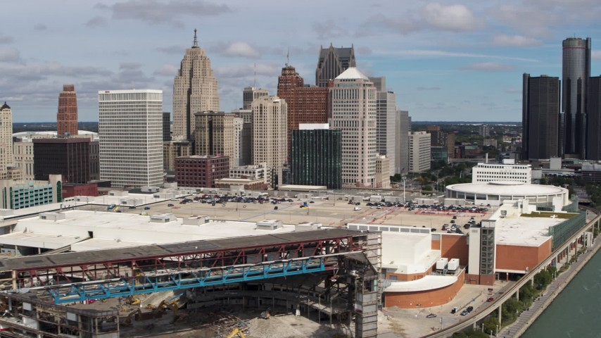 5.7K stock footage aerial video reverse view of skyline, reveal arena and apartment towers, Downtown Detroit, Michigan Aerial Stock Footage | DX0002_189_018