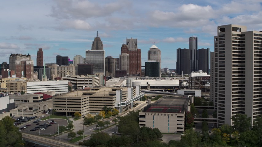 5.7K stock footage aerial video ascend for a view of the skyline, Downtown Detroit, Michigan Aerial Stock Footage | DX0002_189_021