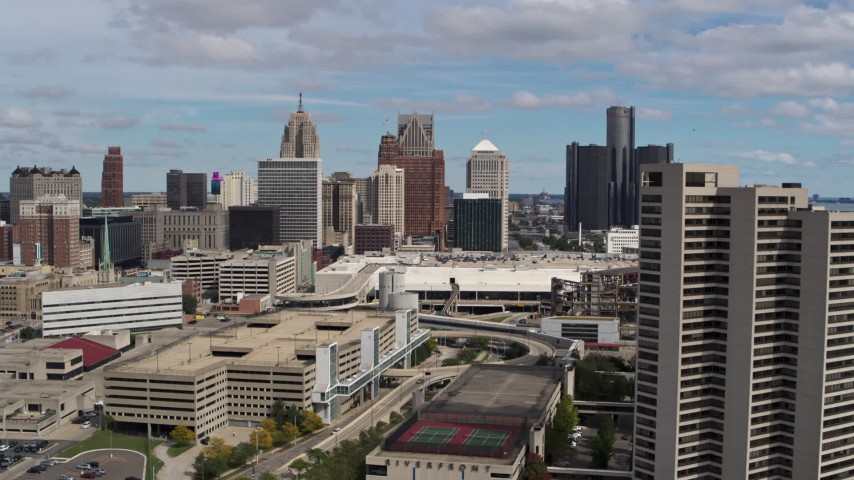 5.7K stock footage aerial video of skyscrapers seen while descending by apartment complex in Downtown Detroit, Michigan Aerial Stock Footage | DX0002_189_023