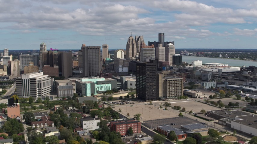 5.7K stock footage aerial video approach the skyline behind office buildings, Downtown Detroit, Michigan Aerial Stock Footage | DX0002_189_027