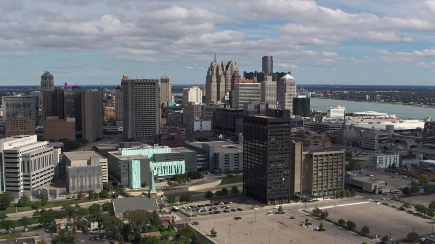 5.7K stock footage aerial video flying by office buildings with a view of the skyline, Downtown Detroit, Michigan Aerial Stock Footage | DX0002_189_028