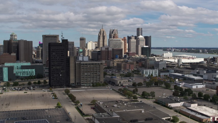 5.7K stock footage aerial video ascend for a view of the skyline, Downtown Detroit, Michigan Aerial Stock Footage | DX0002_189_029