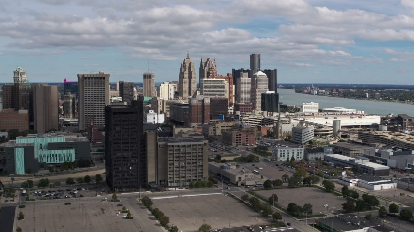 5.7K stock footage aerial video of the skyline behind office buildings, Downtown Detroit, Michigan Aerial Stock Footage | DX0002_189_030
