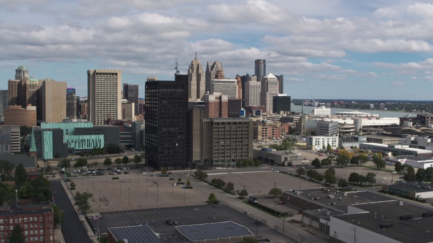 5.7K stock footage aerial video descend with view of office buildings, skyline in background, Downtown Detroit, Michigan Aerial Stock Footage | DX0002_189_032