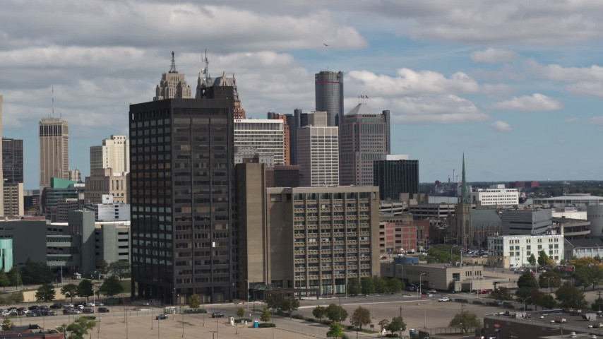 5.7K stock footage aerial video descend and flyby office buildings, skyline in the distance, Downtown Detroit, Michigan Aerial Stock Footage | DX0002_189_035
