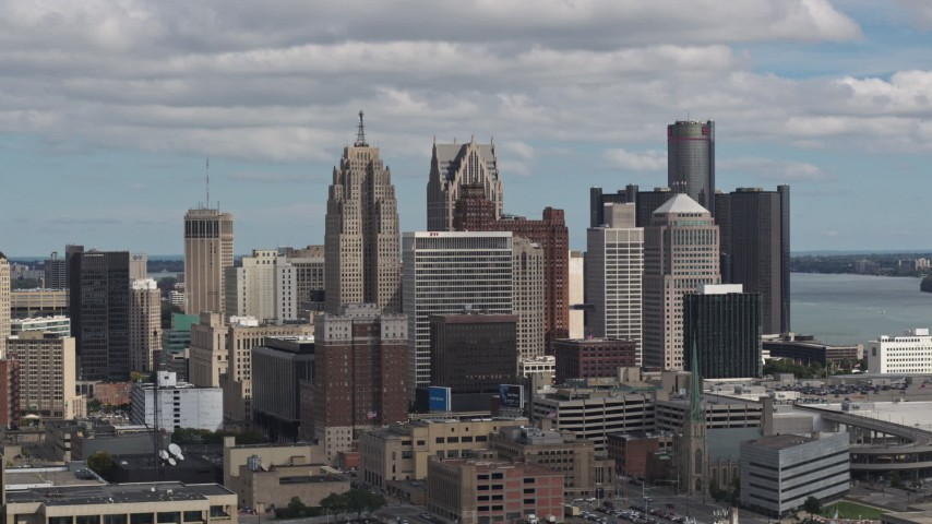 5.7K stock footage aerial video ascend and focus on towering skyscrapers, Downtown Detroit, Michigan Aerial Stock Footage | DX0002_189_037