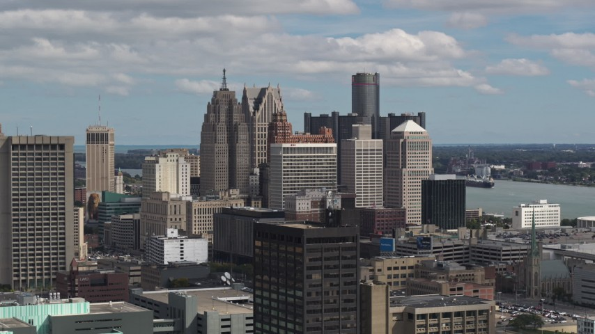 5.7K stock footage aerial video a reverse view of towering skyscrapers, Downtown Detroit, Michigan Aerial Stock Footage | DX0002_189_038