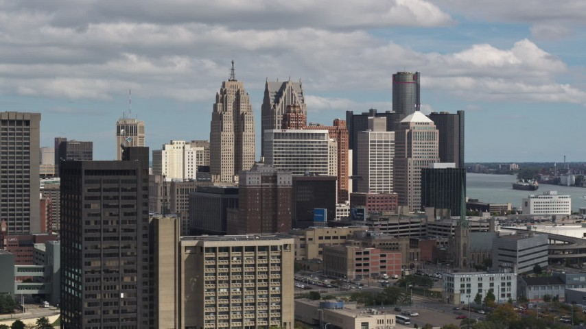 5.7K stock footage aerial video of the city's towering skyscrapers, descend near office buildings, Downtown Detroit, Michigan Aerial Stock Footage | DX0002_189_040