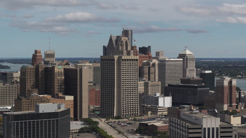 5.7K stock footage aerial video passing by the Patrick V. McNamara Federal Building and skyscrapers, Downtown Detroit, Michigan Aerial Stock Footage | DX0002_189_042