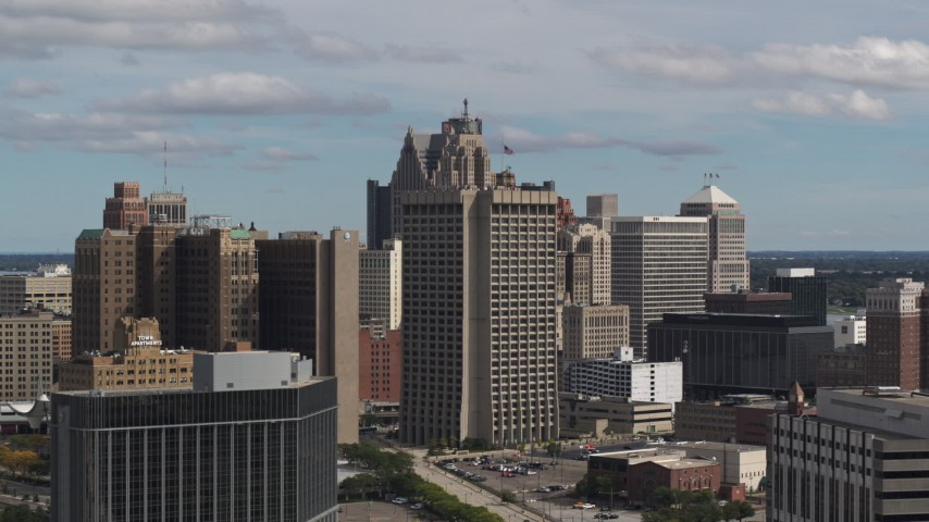 5.7K stock footage aerial video flyby and away from federal building and skyscrapers, Downtown Detroit, Michigan Aerial Stock Footage | DX0002_189_043