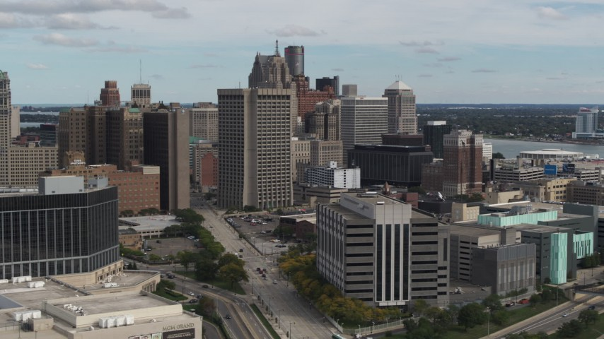 5.7K stock footage aerial video view of federal building while flying by hotel, Downtown Detroit, Michigan Aerial Stock Footage | DX0002_190_008