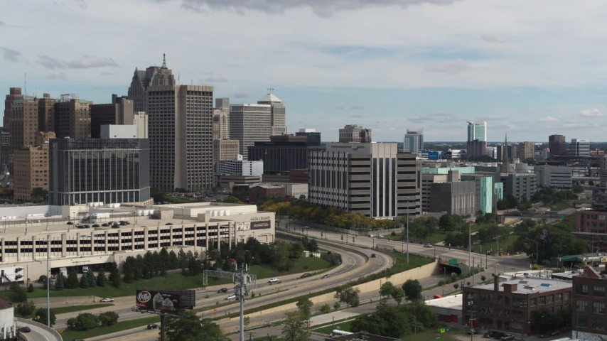 5.7K stock footage aerial video reverse view of hotel and police headquarters, Downtown Detroit, Michigan Aerial Stock Footage | DX0002_190_013