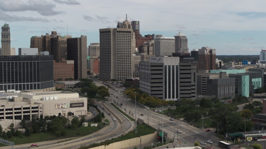 5.7K stock footage aerial video fly away from downtown police headquarters and descend, Downtown Detroit, Michigan Aerial Stock Footage | DX0002_190_016