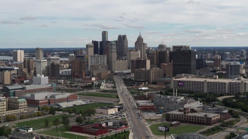 5.7K stock footage aerial video of flying by the towering skyscrapers in the city's skyline, Downtown Detroit, Michigan Aerial Stock Footage | DX0002_190_019