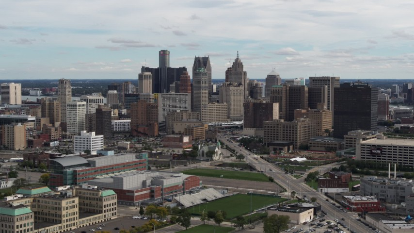 5.7K stock footage aerial video of passing the towering skyscrapers in the city's skyline, Downtown Detroit, Michigan Aerial Stock Footage | DX0002_190_020
