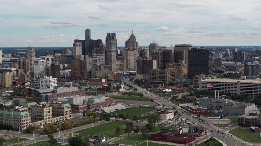 5.7K stock footage aerial video passing the towering skyscrapers in the downtown skyline, Downtown Detroit, Michigan Aerial Stock Footage | DX0002_190_022