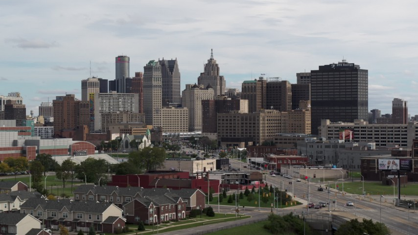 5.7K stock footage aerial video ascending past the giant towers in the downtown skyline, Downtown Detroit, Michigan Aerial Stock Footage | DX0002_190_028