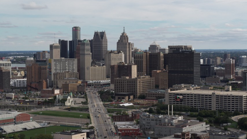 5.7K stock footage aerial video flying by tall skyscrapers in the city's skyline, Downtown Detroit, Michigan Aerial Stock Footage | DX0002_190_029