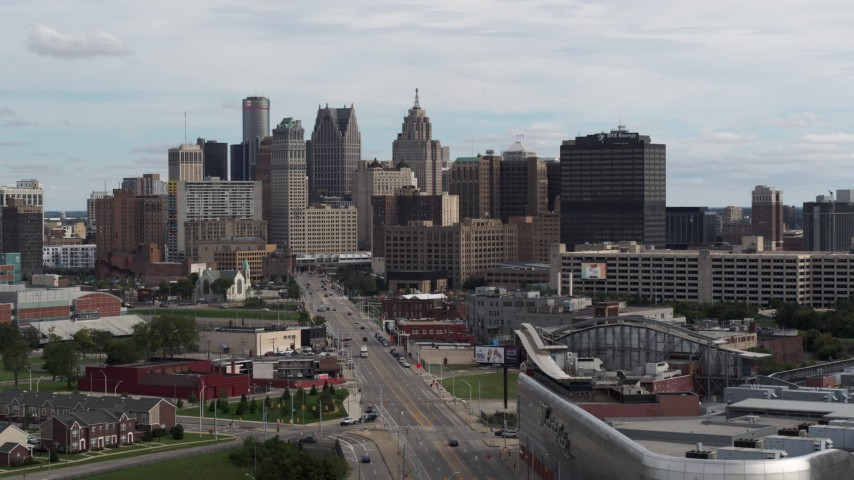 5.7K stock footage aerial video descend by Grand River Avenue, view of the city's skyline, Downtown Detroit, Michigan Aerial Stock Footage | DX0002_190_032