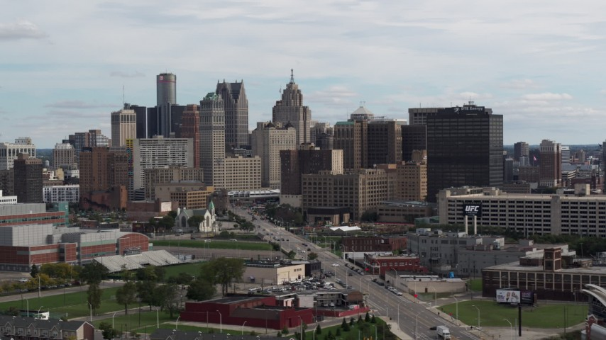 5.7K stock footage aerial video ascend from Grand River Avenue, view of the city's skyline, Downtown Detroit, Michigan Aerial Stock Footage | DX0002_190_033