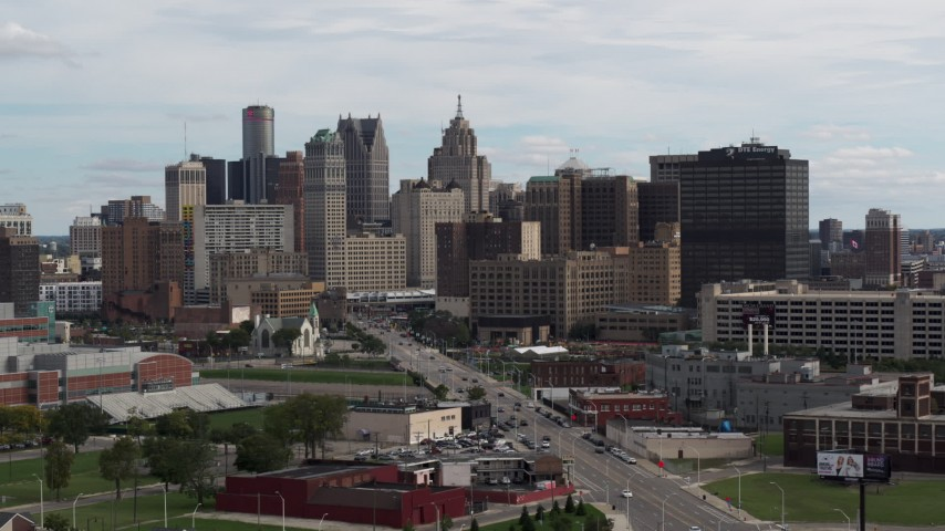 5.7K stock footage aerial video descend near Grand River Avenue, view of the city's skyline, Downtown Detroit, Michigan Aerial Stock Footage | DX0002_190_034