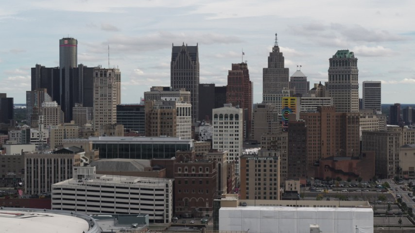 5.7K stock footage aerial video ascend above rooftops for stationary view of the city's skyline, Downtown Detroit, Michigan Aerial Stock Footage | DX0002_190_036